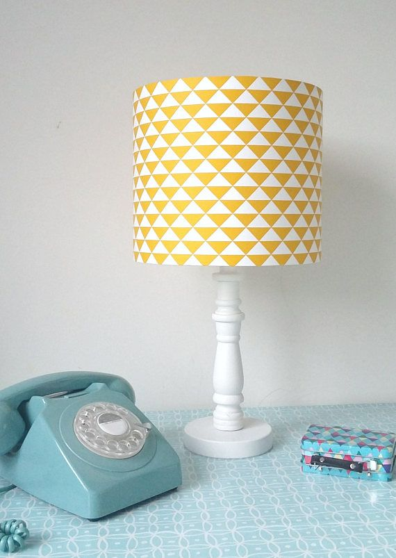 Yellow geometric lampshade, this is funky and on trend. A retro mustard yellow lampshade in repeat triangles. 70s style, classic and retro.