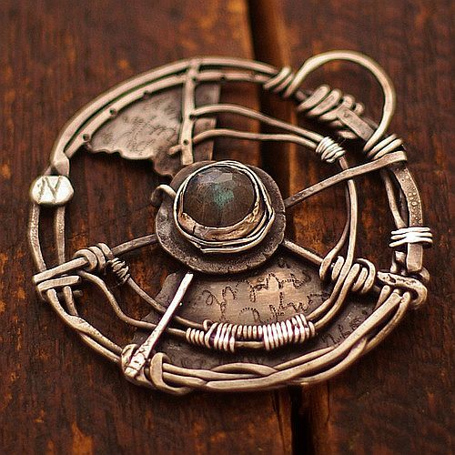 A COMPASS labradorite - cobalt blue ewa Lompa by b f jewelry. Something about this sort of crooked broken fairy tale post-apocalyptic style really appeals to me.