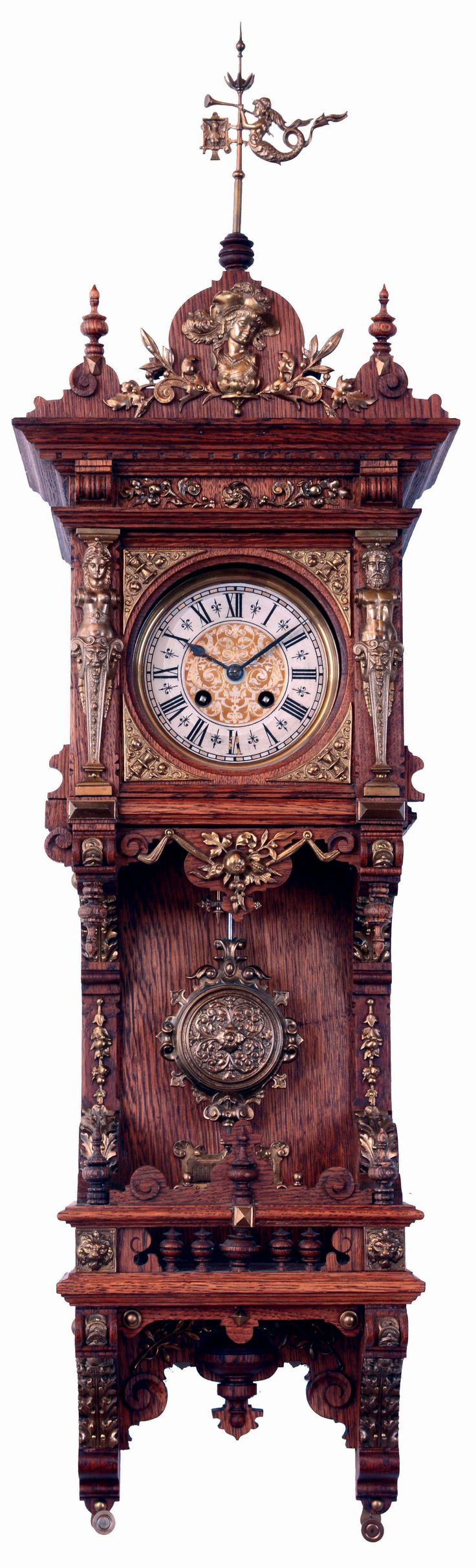 Reloj de pared de madera tallada y aplicaciones de bronce. S.IX