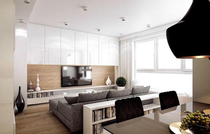salon moderne avec écran plat mural, armoires blanches et canapé gris