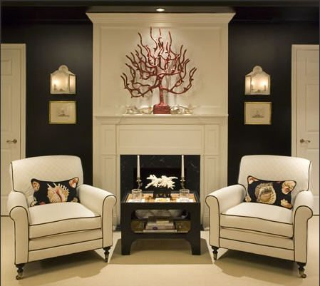 Paint the fireplace column a different color from the walls, cap with crown moulding and viola! a bolder fireplace