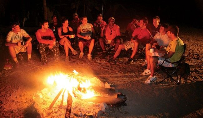 Aussie campfire yarns. Spinning a few yarns and havin' a cuppa on the Wundargoodie Safari. Image by Richard McKenna