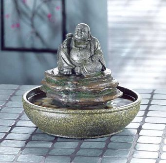 #Buddha Table Fountain.  The Buddha statue sits proudly on top the faux stone finished rocks to remind us to take time out for the important things in life. #fountain #fountains