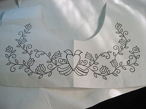 The idea is to find embroidery designs that fill a yoke-shaped pattern piece leaving room for the seam allowances. I look in embroidery design books and at vintage embroidery transfer patterns for ...