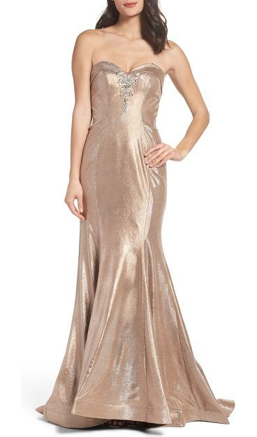 8eb782542b5 metallic mermaid gown by Mac Duggal. Light dances upon this shimmering  metallic gown cut in a curvaceous mermaid silhouette and sewn with  figure-flattering ...
