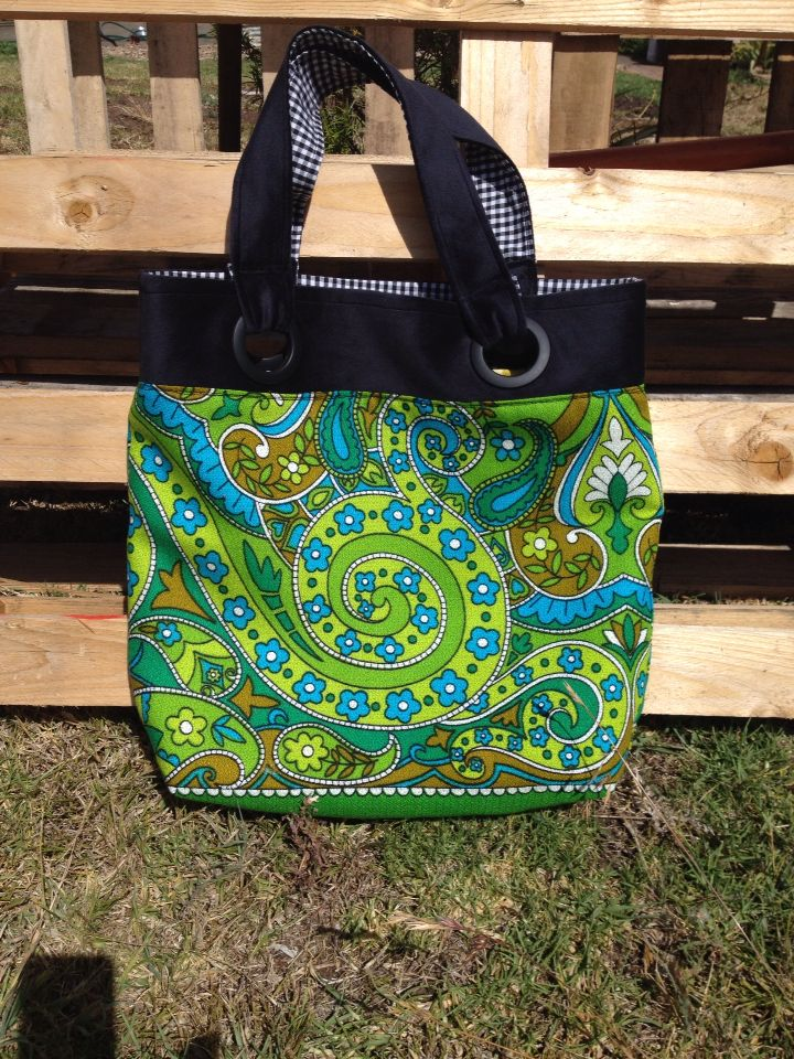 Handmade tote with grommets made from vintage tablecloth.