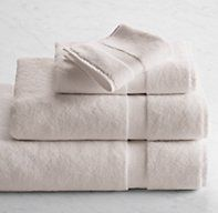 RH's 802-Gram Turkish Washcloth:Wrap up in the world's most luxurious towels, loomed from premium long-staple cotton to a decadent 802-gram weight. Exceptionally dense and soft, they drape beautifully and feel particularly cozy during the cooler seasons. The long, silky loops are extremely absorbent, while the expansive color palette is suited to eclectic mixing or tonal layering.