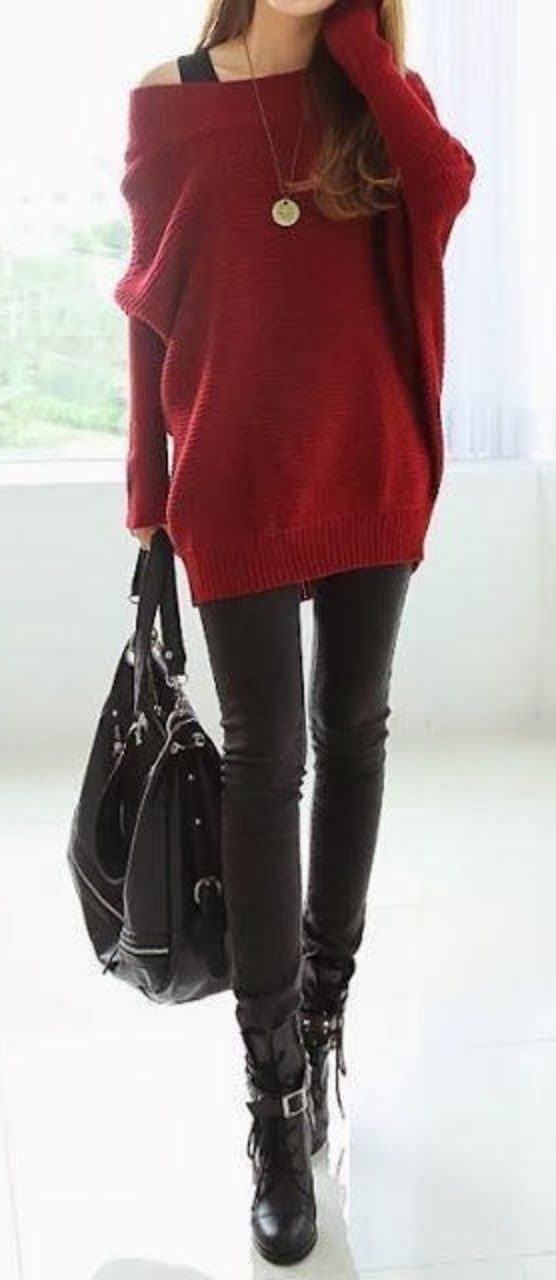 Burgundy loose sweater with black pants and boots
