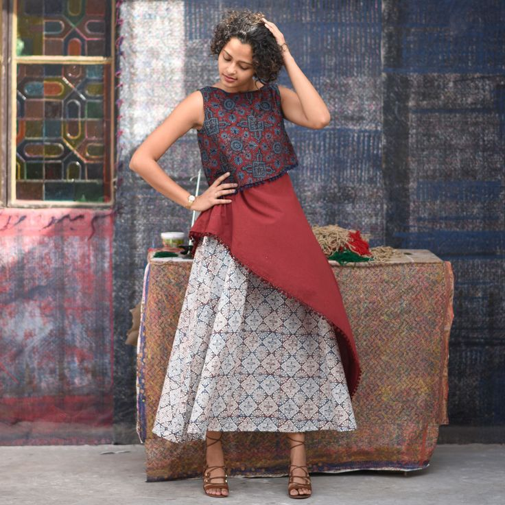 This beautifully crafted collection brings together contemporary silhouettes with vibrant ajrakh and hand block prints. The beauty and exclusivity of ajrakh and hand block prints lies in the craftsmanship of these artisans, who work magic on cotton fabrics with colours and blocks, stamped multiple times in a rhythm. Designed for the modern Indian woman with contemporary cuts and designs, this collection is a beautiful example of modern meets traditional. You cannot afford to miss having…
