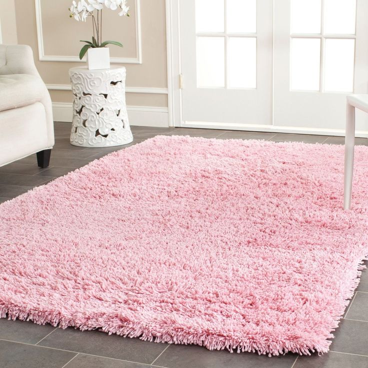 This hand-woven acrylic shag rug offers luxurious comfort and style. High-density acrylic pile features a pink background and provides one of the most plush feels available in a rug.