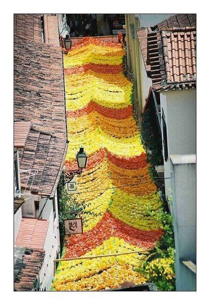 """The festival """"Festa dos Tabuleiros"""" in Tomar is, for centuries, one of the most beautiful traditions of Portugal. The streets are decorated with natural and paper flowers. #Portugal"""