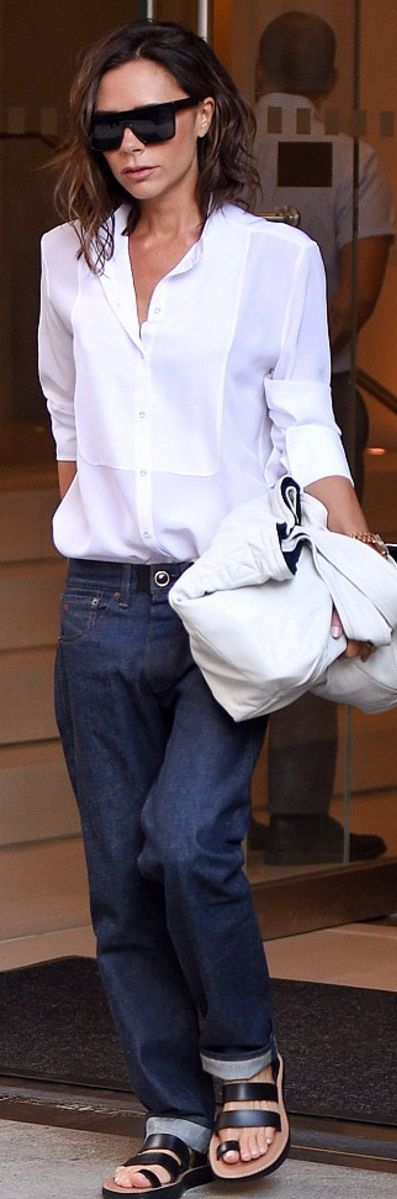 Who made  Victoria Beckham's black flat sunglasses, sandals, and white shirt?