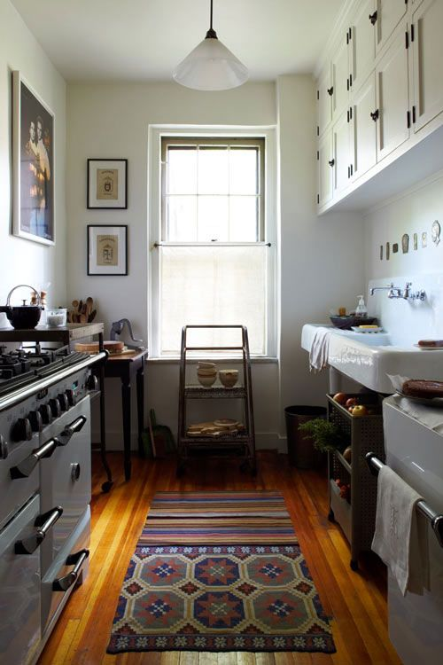 white galley kitchen We need a colorful rug