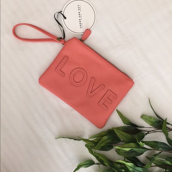 "Under One Sky LOVE Clutch Fun and girly clutch bag by Under One Sky. Fits all the essentials! Color is a lighter coral pink, almost peach. Size; approximately 8.5""w x 6.25""w. Has a wrist strap, zipper top and one interior zipper pocket. Under One Sky Bags Clutches & Wristlets"
