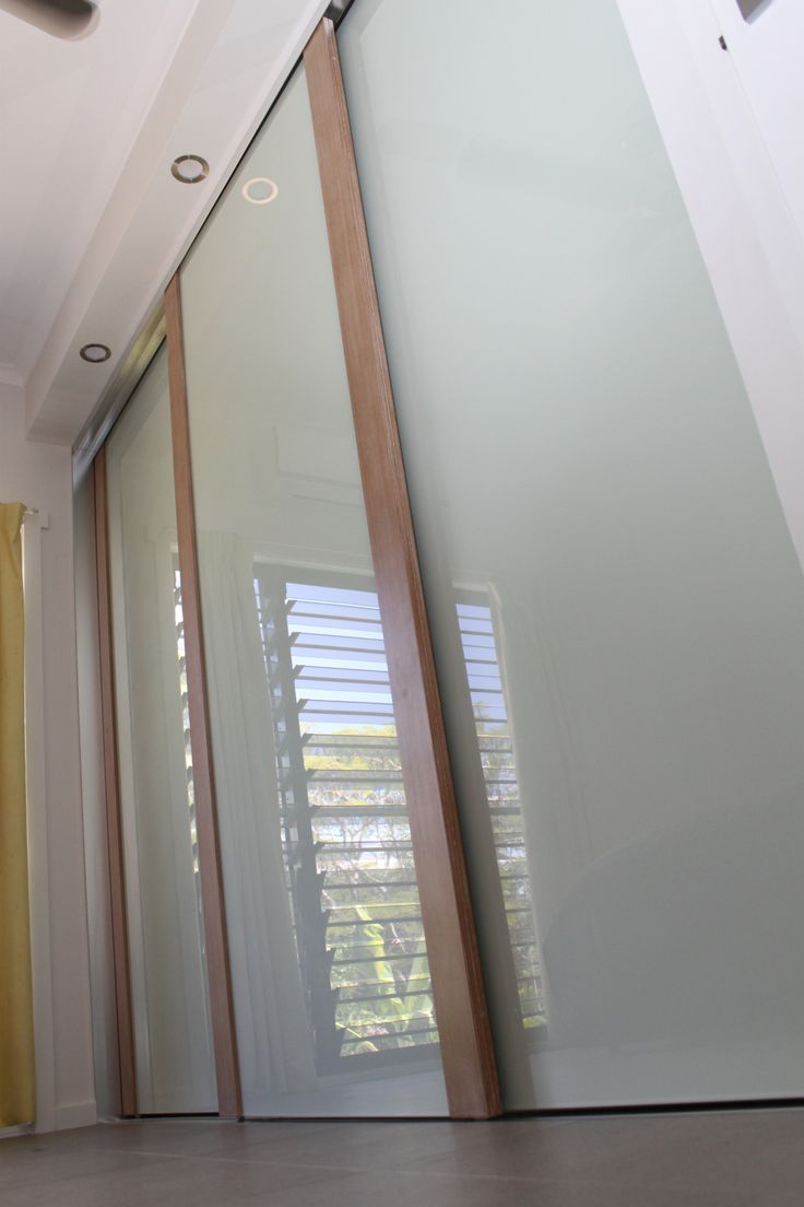 Infinity Sliding Doors using limed (white wash) Tassie Oak and white decor glass