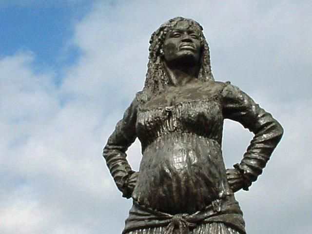 THIS IS A STATUE OF THE AFRICAN FREEDOM FIGHTER IN GUADELOUPE KNOWN TO HISTORY AND LEGEND AS SOLITUDE. SHE WAS A GREAT SHERO IN THE STRUGGLE OF THE AFRICANS IN GUADELOUPE TO END SLAVERY MORE THAN 200 YEARS AGO. SHE WAS CAPTURED BY THE FRENCH WHEN SHE WAS PREGNANT AND EXECUTED THE DAY AFTER HER BABY WAS BORN. SHE WAS BORN ABOUT 1779 AND HANGED IN 1802. HER NAME IS SOLITUDE. SHE IS IMMORTAL!'