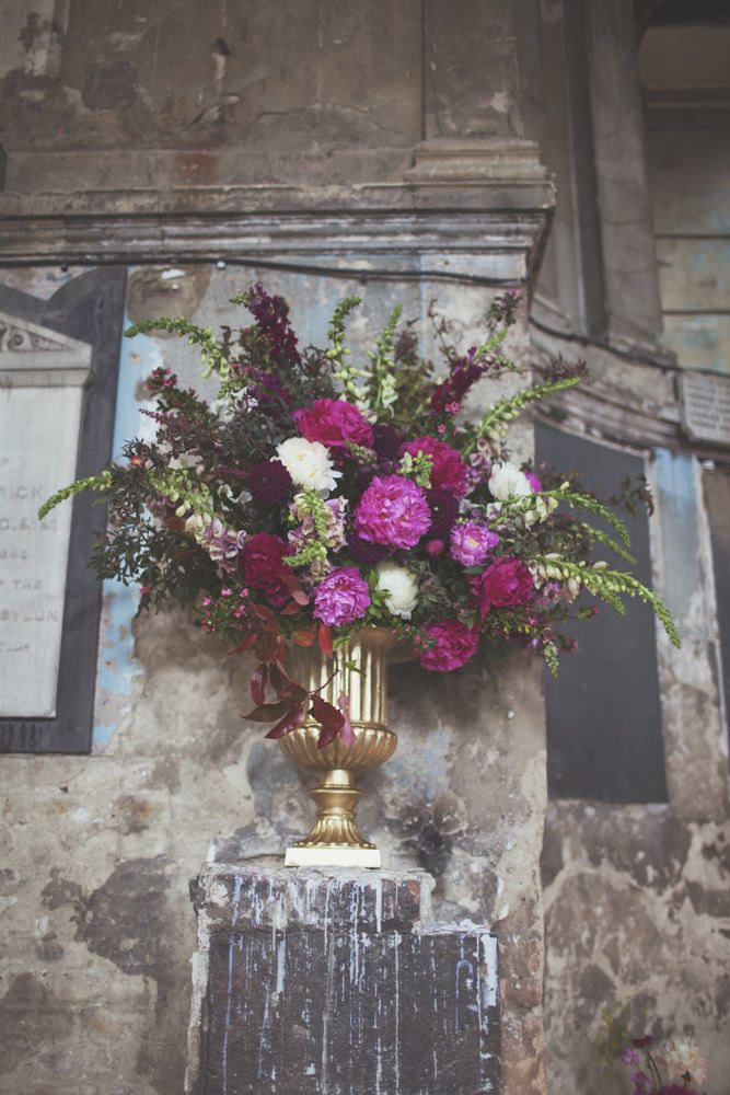 Giant Gold Urn Depp Pink  & Plum Flower Displays    The Asylum London & Garden Museum Wedding Venues Deep Jewel Pink & Gold Colour scheme   Gemy Maalouf Couture Gown from Morgan Davies Bridal   On Love and Photography   http://www.rockmywedding.co.uk/francesca-tony/