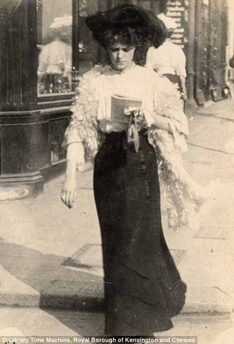 A 'shopgirl' walks along Church Street, Kensington, London- 8 September 1906