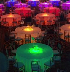 Colorful bright lights under the tables - dig it! The table centerpieces seem to be LED light up too - lovely, use these for such DIY endeavors: http://www.flashingblinkylights.com/ledsubmersiblecraftlights-c-114_462.html