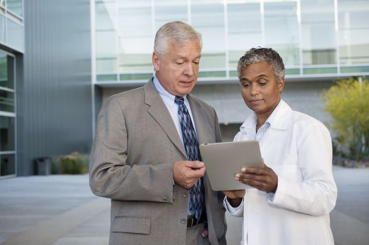 doctor and adminstrator using tablet pc