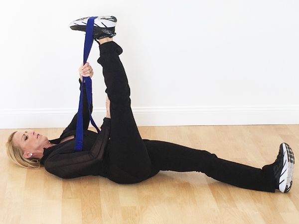 Hamstring Back Stretch Lie Flat On The Ground With Right Leg Extended And Put On Ground Place Strap Safely Over The Arch Of Outer Thighs Back Stretches Thighs