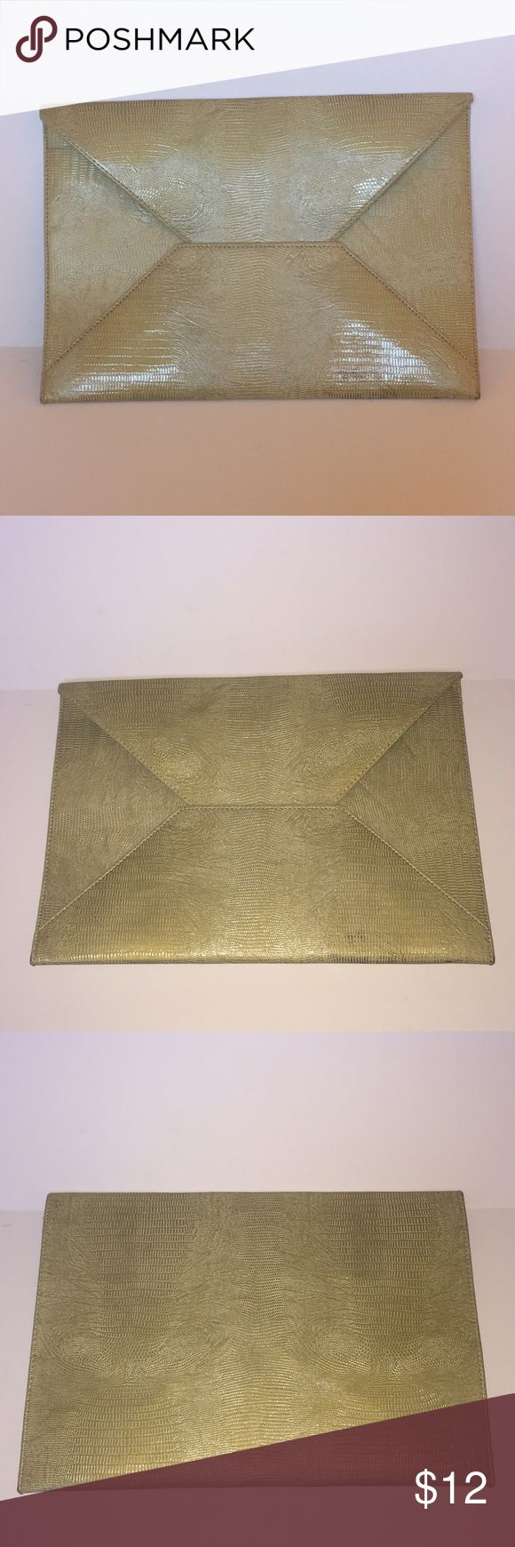 Envelope Clutch Large Envelope Clutch/Animal Print/Thin & Light Weight ***Seller Note*** Minor mark on bottom of Clutch. Picture shown. Unnoticeable when carrying. Almost camouflages into print of bag. May be able to be rubbed out with some alcohol. Bags Clutches & Wristlets