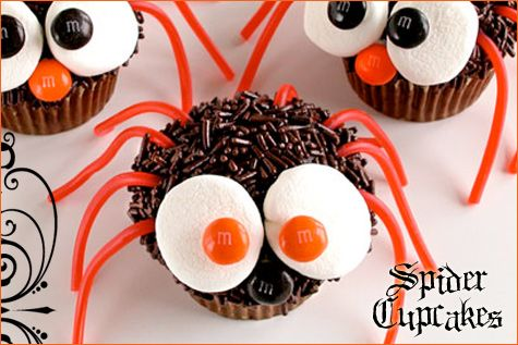 Cute Halloween cupcakes.  Use marshmallows cut in half with the sticky side up so that the m's will stick.