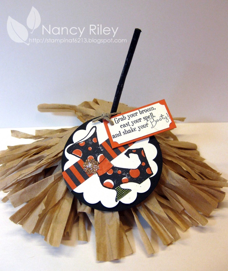 The stick is actually a Tootsie Pop colored in black marker. The rest of the sucker is hidden under the boom created from natural colored coffee filters.