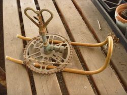 Rustic Salvage - the Sprinkler: I spotted this uniquely refurbished sprinkler in a greenhouse that was being rebuilt.  It's a perfect example of someone being really creative...
