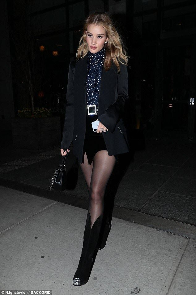 Rosie Huntington-Whiteley steps out in black shorts and heeled boots