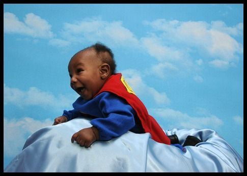 Bookish Halloween costumes for children: baby Superman. His face is so cute!!