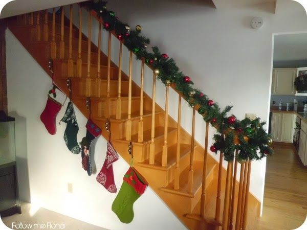 No fireplace mantle hang stockings on staircase instead for Hang stockings staircase