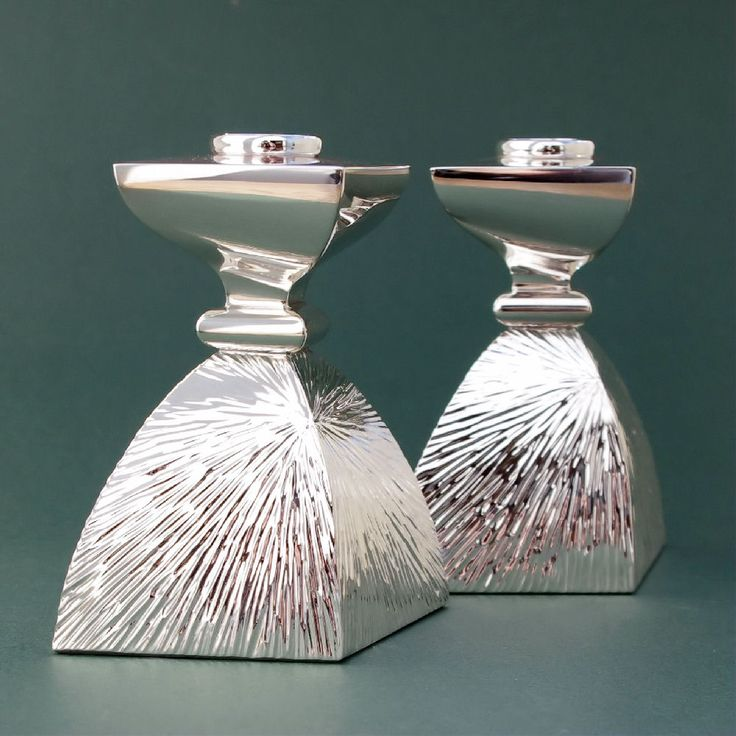 Silver candlesticks radiant ripple texture on base with offset polished tops