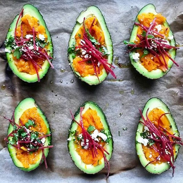 Avocados Filled With Pumpkin Hummus, Feta Cheese, Cilantro And Beet Sprouts