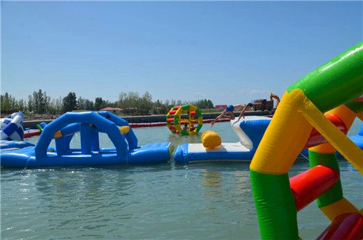 #Inflatable #floating #waterpark #waterplayground #sport on swimming pool water #Toys #pool, #Lake, #oceanside, #Park, water #resort #hotel for entertaiment, amusement equipment play. QH Group Amusement Equipment Co.,Ltd, which has mainly specialized in manufacturing,  technology developing, and selling high-quality inflatable toys, trampoline,  basketball shooting machine, kids battery car, clip doll machine for over 10 years.