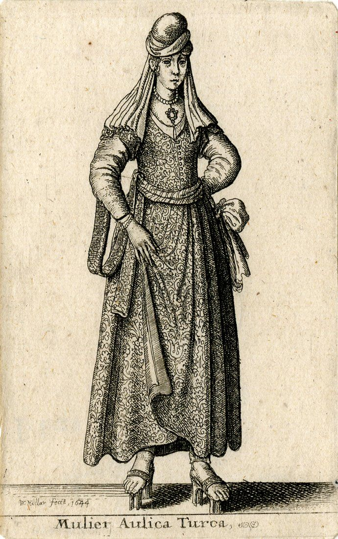 Costume print, whole-length figure of a standing Turkish woman, head slightly to right, in long brocaded dress with short sleeves over another garment, tied at waist with a wide scarf knotted in a bow at right, her right hand to front in the folds of her skirts; with turban hanging in folds over her shoulders, necklace, and pattens on tall blocks.