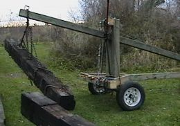 Trailer Crane - Homemade trailer crane constructed from channel iron and powered by a chain hoist.