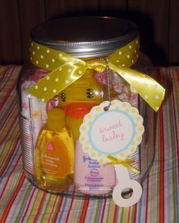 Make one for a friend's baby shower using the large sized jar from Hobby Lobby. It fit 5 washcloths, shampoo, baby bath, lotion, a hooded towel, rubber ducky & a taggie toy.