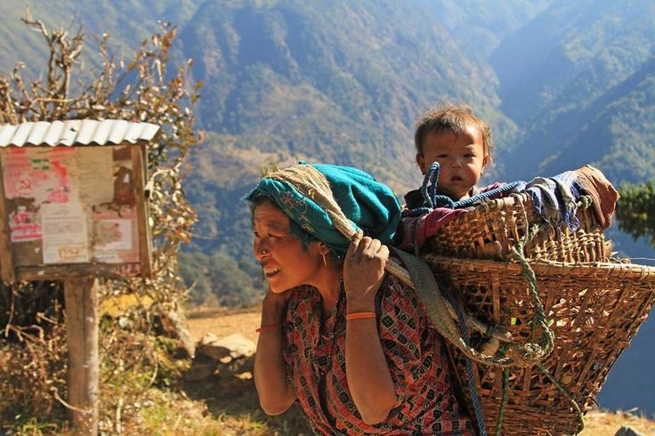 """We meet and work with real life """"superwomen"""" everyday. Here, a lady from Chheskam is carrying her baby and fodder for livestock. #Nepal"""
