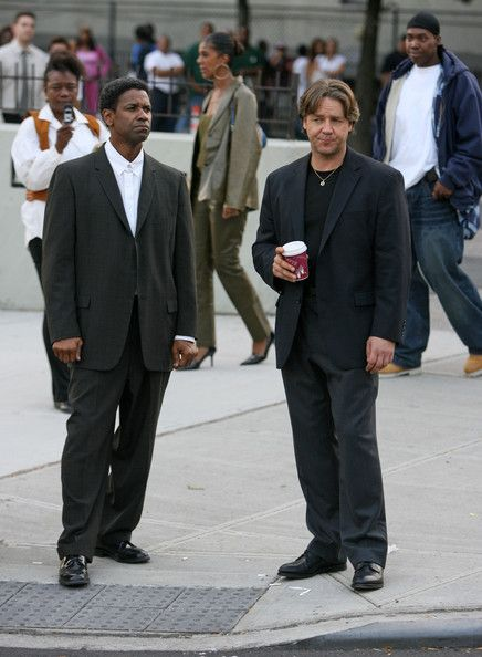 "Russell Crowe Photos Photos - Denzel Washington & Russell Crowe film a scene on the set of ""American Gangster,"" under the direction of Ridley Scott in Harlem, NewYork. - Denzel Washington and Russell Crowe on Set"