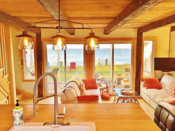 This one-of-a-king workspace and gathering spot has true oceanfront views with original beams overhead.