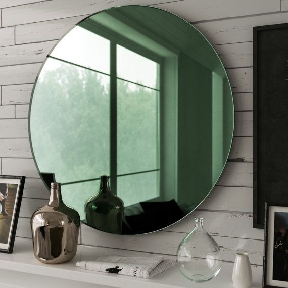 top of stairs glass bathroom cube with mirror to obscure most of bathroom. only can see the floor and some of the ceiling  Round Green mirror. Frameless mirror with bright green glass mirror and interesting, chic round shape. This large round mirror makes a perfect