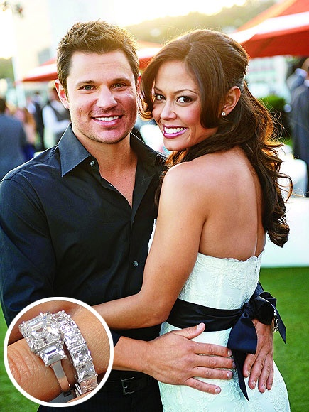 Nick Lachey popped the question to Vanessa Minnillo with this Asscher-cut diamond flanked by two side diamonds.  Her eternity wedding band features princess cut diamonds in a white setting.