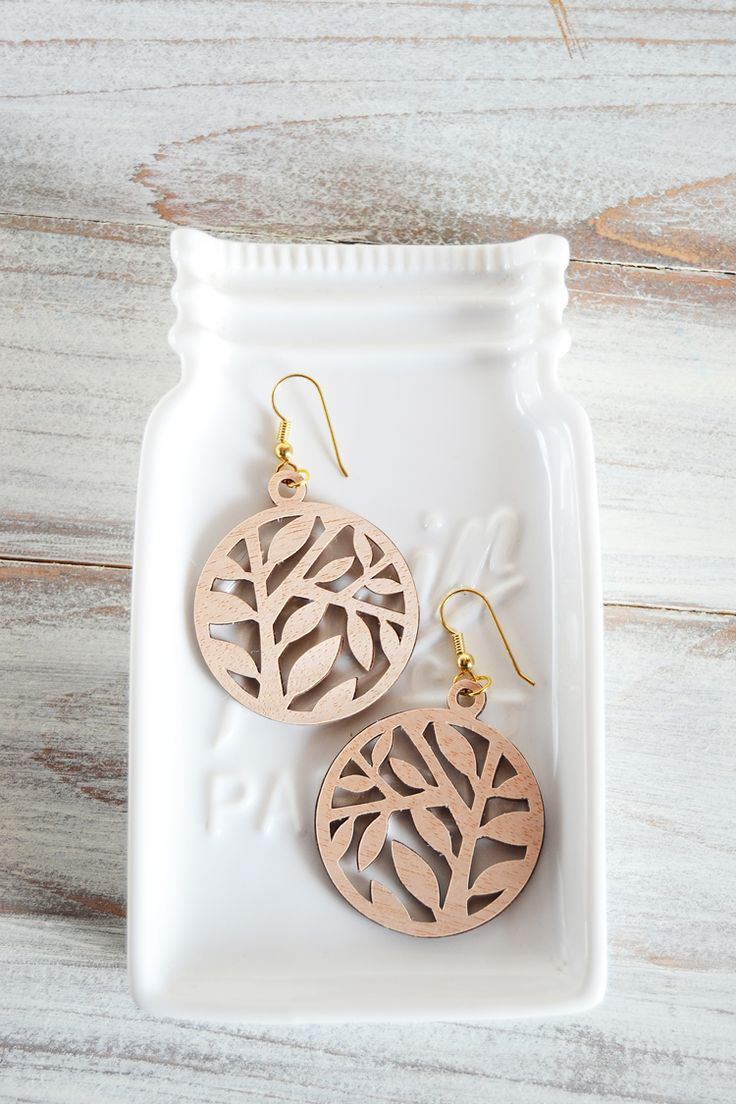 Learn how to create fun faux lasercut wood earrings with paper and wood veneer!