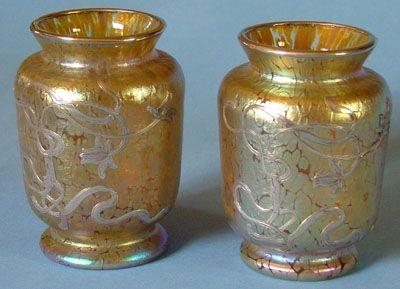 LOETZ A delightful small pair of silver overlay Loetz vases on papillon gold ground. Date c1900.
