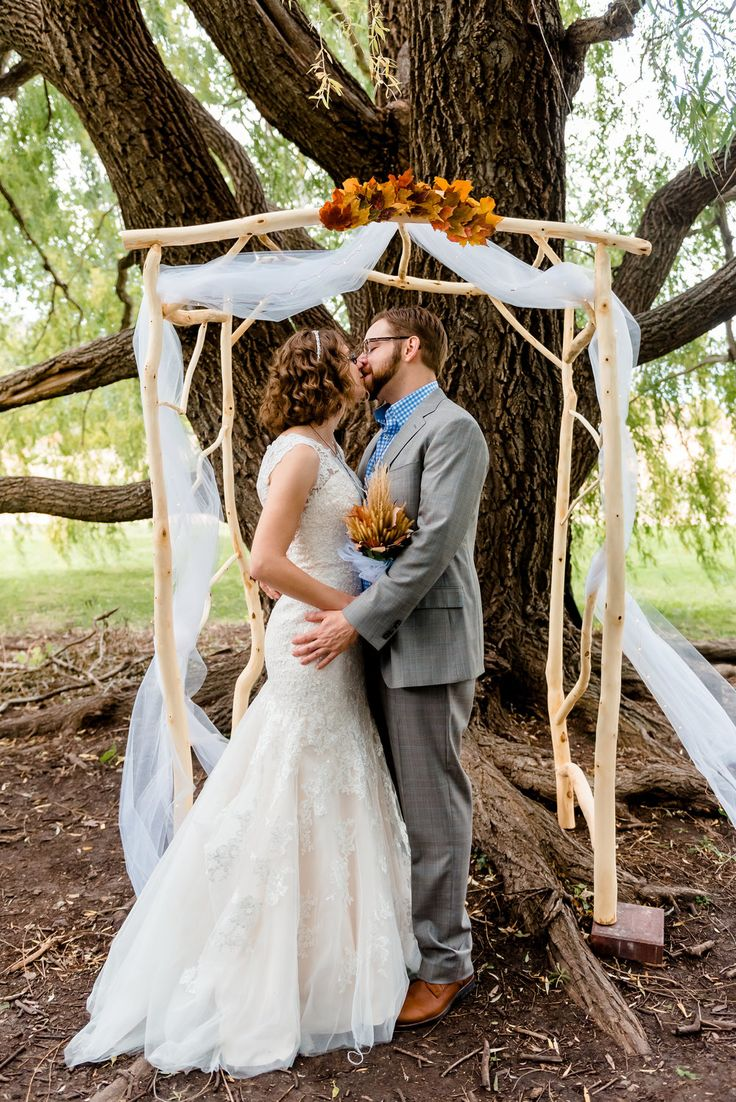 outdoor wedding venues minneapolis%0A Bride and groom under DIY wooden wedding arch for fall wedding  Weeping  Willow Trees ceremony site at MN Landscape Arboretum  Minnesota u    s most  beautiful