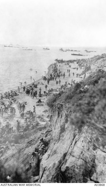 An elevated view of the beach, crowded with Australian and New Zealand troops the day after the landing at Anzac Cove, Gallipoli. Ships can be seen in the background April 26, 1915. Australian War Memorial A03868.