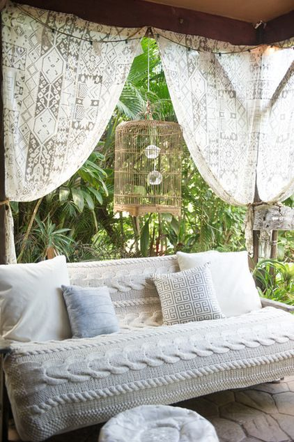 Cozy outdoor patio- lots of greenery and white.
