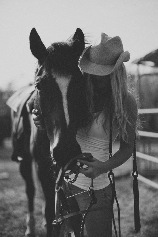 Simple western clothing, white tank top, jeans and cowboy hat, for a photo shoot with your horse.