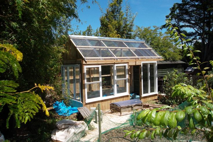 Greenhouse made from recycled windows recycled windows for Reclaimed window greenhouse